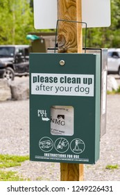 CANMORE, ALBERTA, CANADA - MAY 2018: Sign in a public car park in Canmore, Alberta, asking dog owners to clean up any mess from their dog.