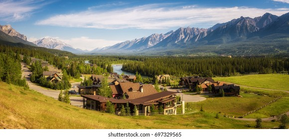 CANMORE, CANADA - JUNE 26, 2017 : Canmore in the Rocky Mountains with mountain peaks in background. Canmore is located in the Bow Valley near Banff National Park and is a popular tourist destination.