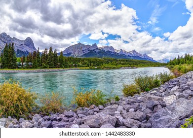 Canmore's Bow River Loop Trail on the southern Banff range of the Canadian Rockies in Alberta with Ehagay Nakoda, Ha Ling Peak and Mt Rundle in the background.