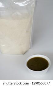 Canna edulis Ker. or ganyong porridge (front) and Canna edulis Ker. flour (behind).
