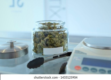 cannabis buds in jar with scale for sale  in recreational dispensary