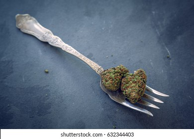 Cannabis Buds On A Vintage Silver Fork On Dark Slate Background. Selective Focus With Copy Space.