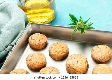 Cannabis butter cookies with marijuana buds and cannaoil, homemade healthy biscuits in a baking tray with a place for text