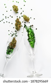 Cannabis in champagne flutes cheers for celebration. Cannabis confetti concept for New Years, Birthday, Party, anniversary and wedding.