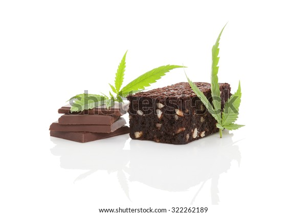 Cannabis chocolate and cannabis brownie with ganja leaf isolated on white background.