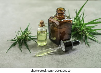 cannabis essential oil container with cannabis leaves and cannabis seeds