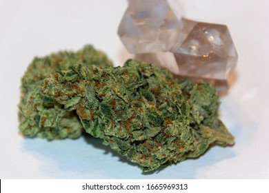 Cannabis flower buds with quartz crystals natural healing concept