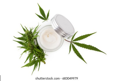 Cannabis hand cream in silver dose with marijuana plant, isolated on white background from above. Cannabis cosmetics.