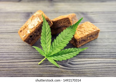Cannabis Hash brownies with cannabis leaf on wooden table