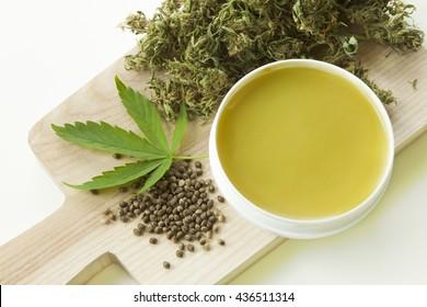 Cannabis healing ointment green marijuana leaf and seeds