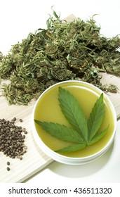 Cannabis healing ointment and marijuana green leaf and seeds