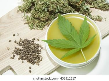 Cannabis healing ointment and marijuana leaf and seeds