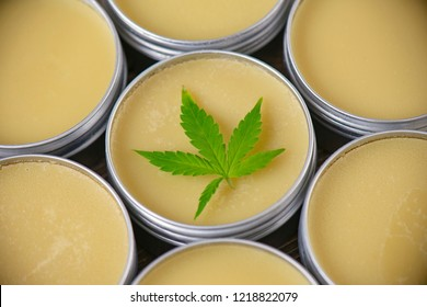 Cannabis hemp cream background with marijuana leaf - cannabis topicals concept