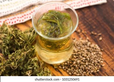 Cannabis herbal tea on wooden background