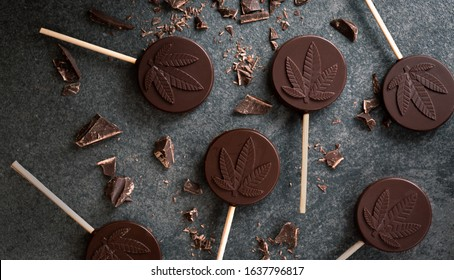 Cannabis infused chocolate lollipops with THC and CBD oil.