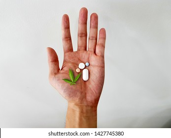 Cannabis leaf and medicine in human hand. Cannabis (marijuana) is a psychoactive drug used for medical purpose as  treatment for cancer, Parkinson disease, seizure and glaucoma. medical concept
