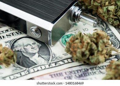 Cannabis Marijuana Vaporizer with Medical Marijuana Buds on US Dollar bill. Vaporizer Marijuana Dollar