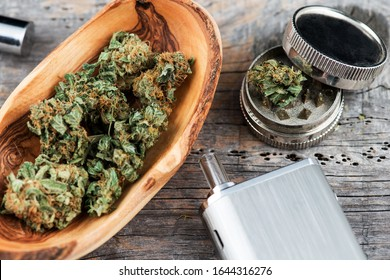 Cannabis Marijuana Vaporizer with Medical Marijuana Buds and grinder. Vaporizer Cannabis Marijuana Buds THC Oil CBD