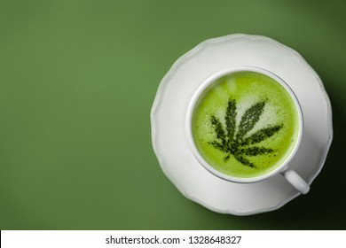 Cannabis matcha tea latte on green background, copy space