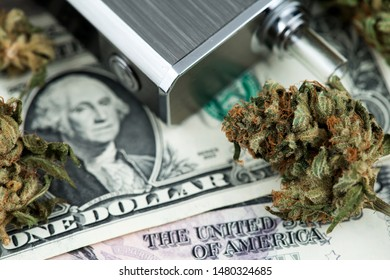 Cannabis Medical Marijuana Buds on One Dollar bill next to Marijuana Vaporizer close up image. Dollar Marijuana Vaporizer Cannabis