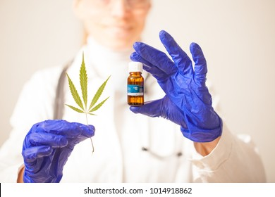 cannabis oil in the doctor's hand hemp leaf