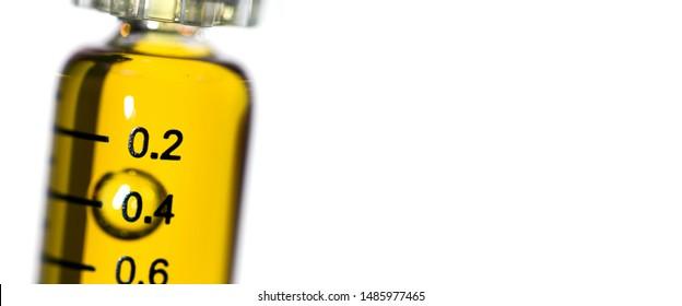 Cannabis Oil, for Vaping with Vape Pen, in Syringe on White Background.