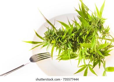 cannabis on a plate with a fork. alternative medicine healthy food