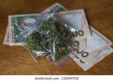 cannabis is packaged. marijuana lays on cash money hryvnia. concept of drug trafficking