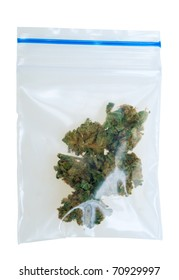 Cannabis in a plastic bag , photo taken with a macro lens, isolated on a white background