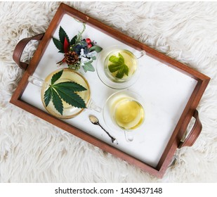 Cannabis Tea pot with cannabis leaves, cannabis flowers, buds. Marijuana Tea