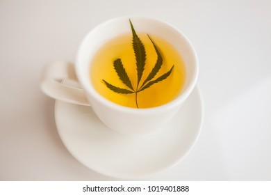 cannabis tea white cup
