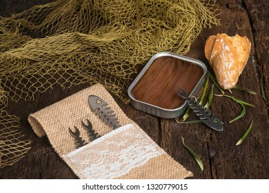 Canned  artisan anchovies from Cantabrian salting with olive oil on a rustic wooden table