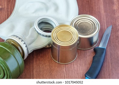 canned food and a knife with a gas mask in case of gas attacks, personal protective equipment, Russian items