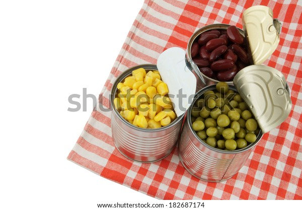Canned food on tablecloth isolated on white