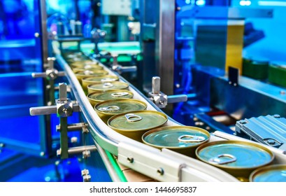 Canned food products on conveyor belt in distribution warehouse.parcels transportation system concept.