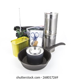 Canned foods, emergency radio and supplies for disaster preparedness on white background