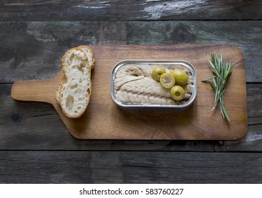 Canned mackerel can on rustic wooden table