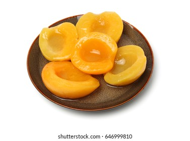 Canned peach on syrup over white background