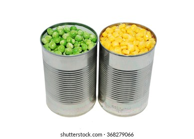 Canned peas and corn on a white background