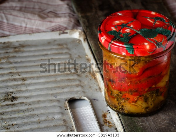 Canned peppers (antipasti) on the table