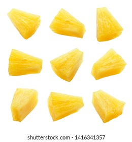 Canned pineapple chunks. Pineapple slices isolated. Set of pineapple chunks. Clipping path.