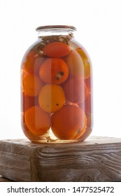 Canned red and yellow tomato in jar