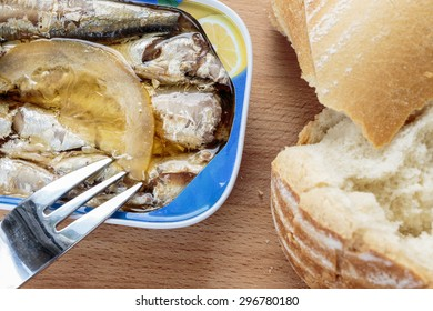 Canned sardines on wooden table