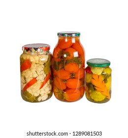 Canned vegetables in glass jars isolated on white background. Tomatoes, squash, cauliflower carrot, red pepper, parsley, pickle
