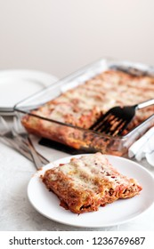 Cannelloni with minced meat, tomato sauce and parmesan cheese