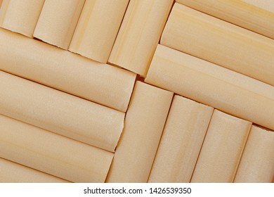 Cannelloni pasta background. Raw, uncooked. Top view, close-up.
