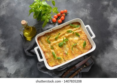 Cannelloni pasta stuffed with spinach, mushrooms,ricotta and sauce bechamel. Italian cuisine. Traditional food for Shavuot Jewish holiday