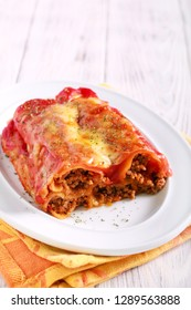 Cannelloni - pastry tubes stuffed with mince meat in tomato sauce