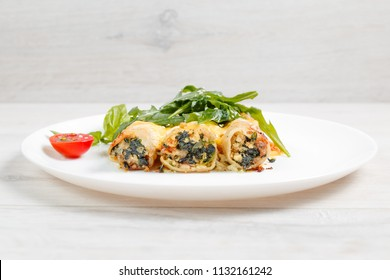 Cannelloni with spinach, cheese and bechamel sauce.
