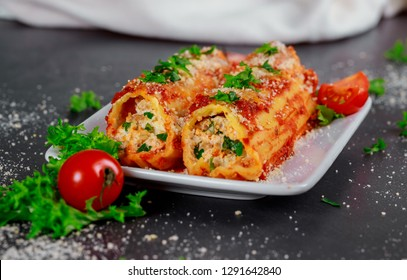 Cannelloni with spinach and ricotta meat tomato sauce